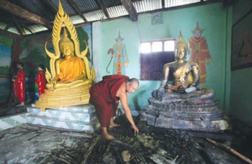 Burnt Buddhist temple 370 (photo credit: REUTERS)