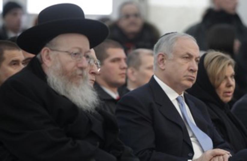 Litzman sits with Netanyahu 370 (photo credit: REUTERS/Peter Andrews)