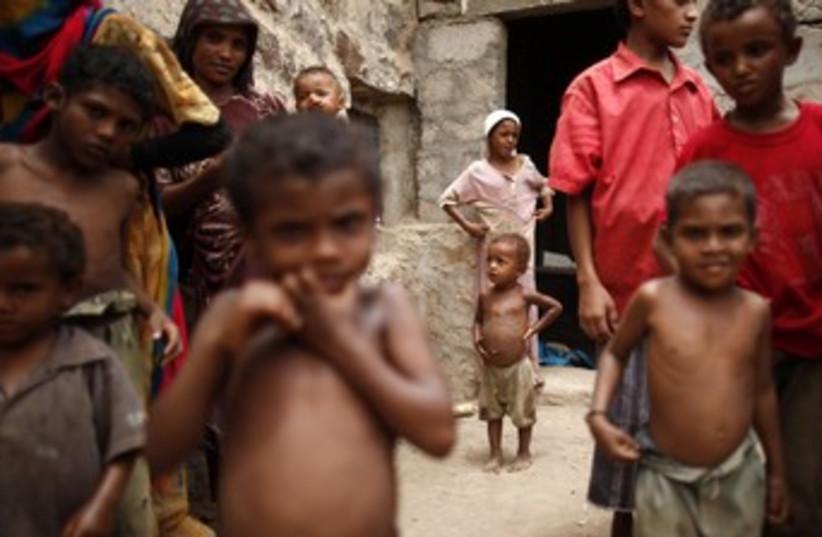 children suffering from malnutrition 370 (photo credit: REUTERS/Khaled Abdullah Ali Al Mahdi)