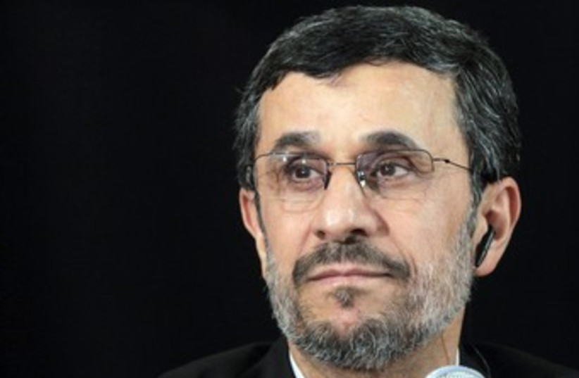 Iranian President Mahmoud Ahmadinejad (black background) 370 (photo credit: REUTERS/Brendan McDermid)