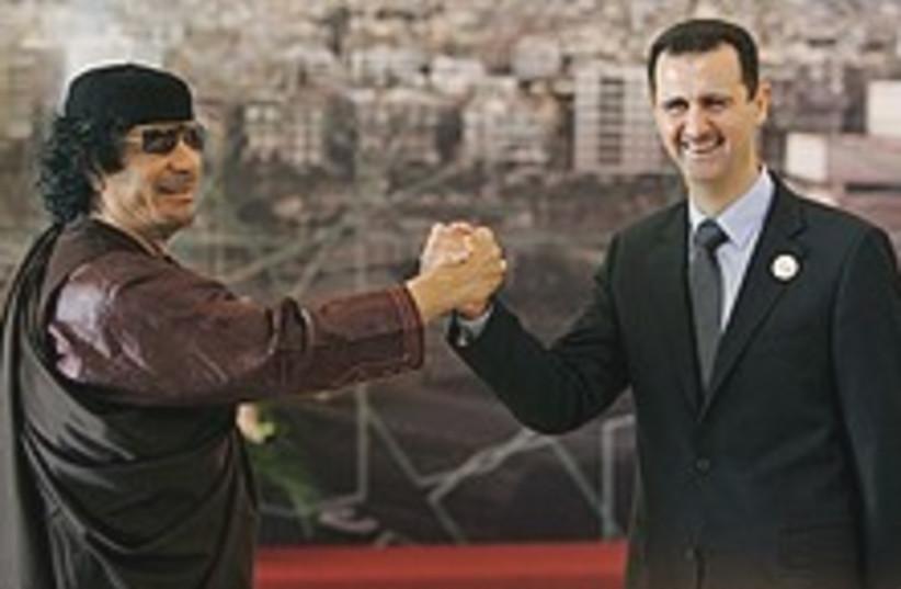 Assad Gadhafi yo yo 224. (photo credit: AP)