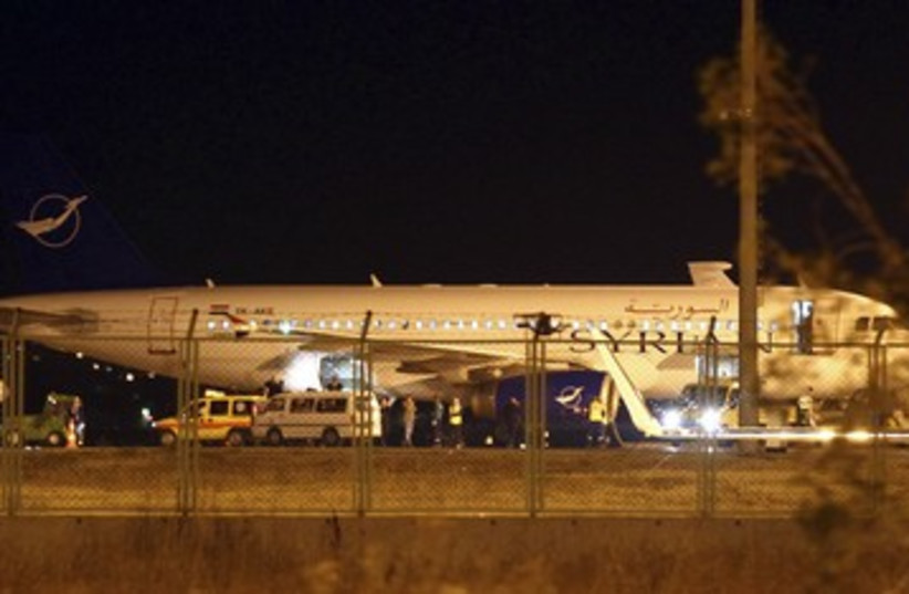 Syrian plane diverted to Turkey 390 (photo credit: Reuters)