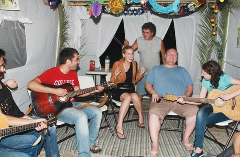 Jam session in public succa (photo credit: Moshe Goldberg)