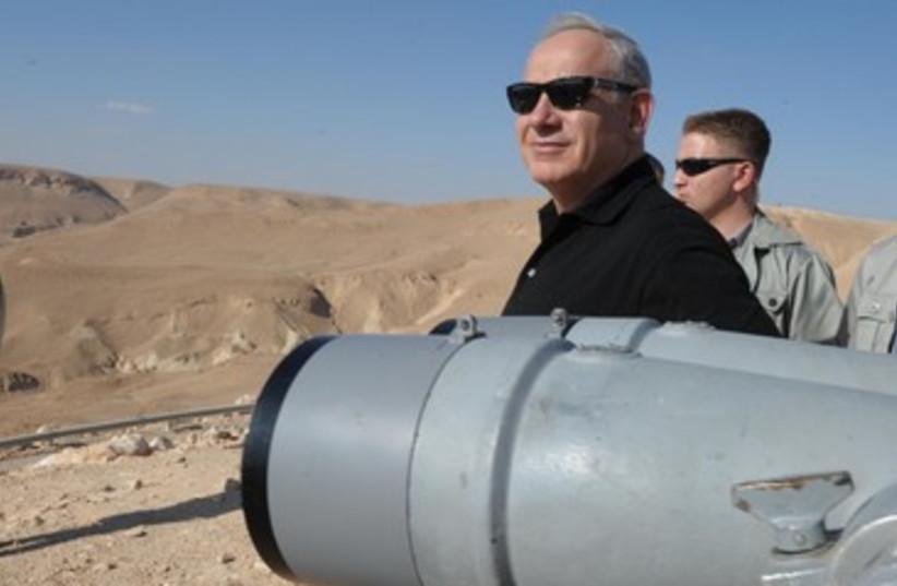 Prime Minister Binyamin Netanyahu on tour of South 370 (photo credit: GPO/Moshe Milner)