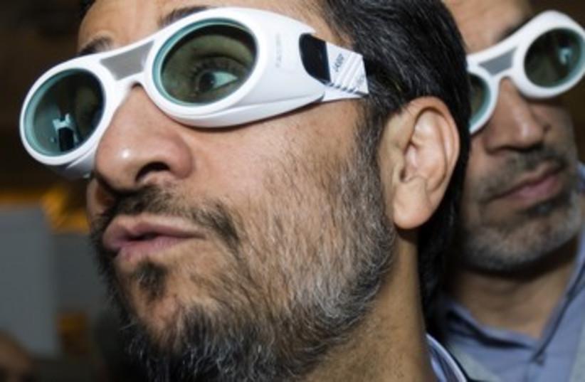 Iran Mahmoud Ahmadinejad laser conference goofy glasses 39 (photo credit: REUTERS/Raheb Homavandi)
