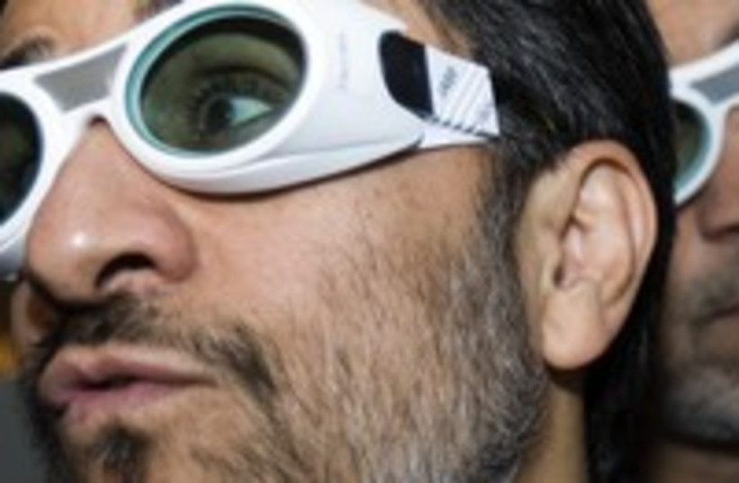 Iran Mahmoud Ahmadinejad laser conference goofy glasses 300 (photo credit: REUTERS/Raheb Homavandi)