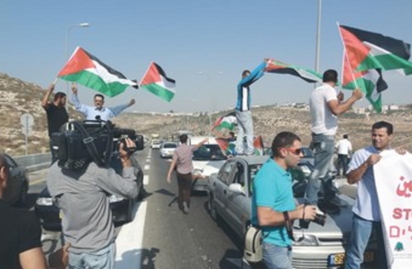 Palestinians, activists block Route 443 370 (photo credit: Marshall Pinkerton)