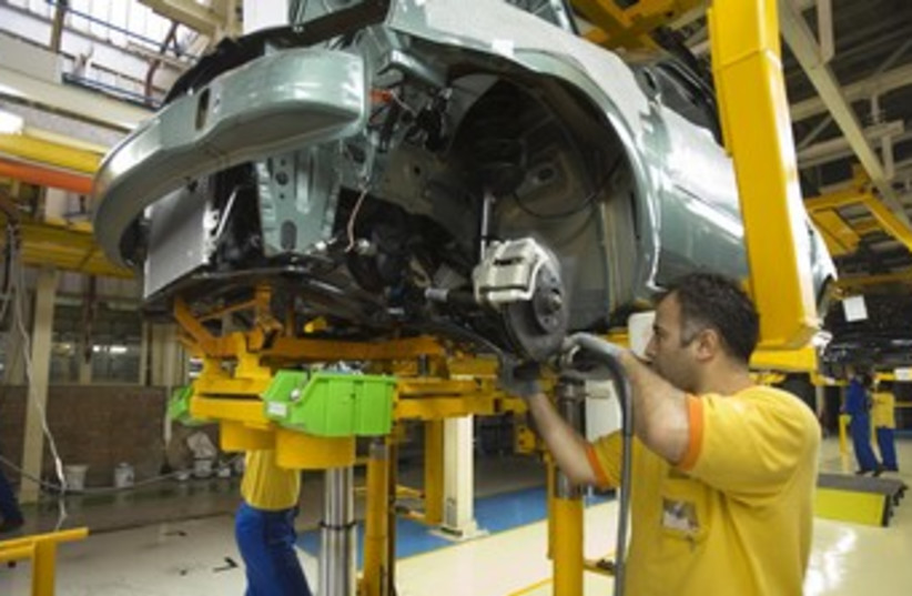 Iranian employees assemble car in Tehran plant 370 (photo credit: Miro Maman)