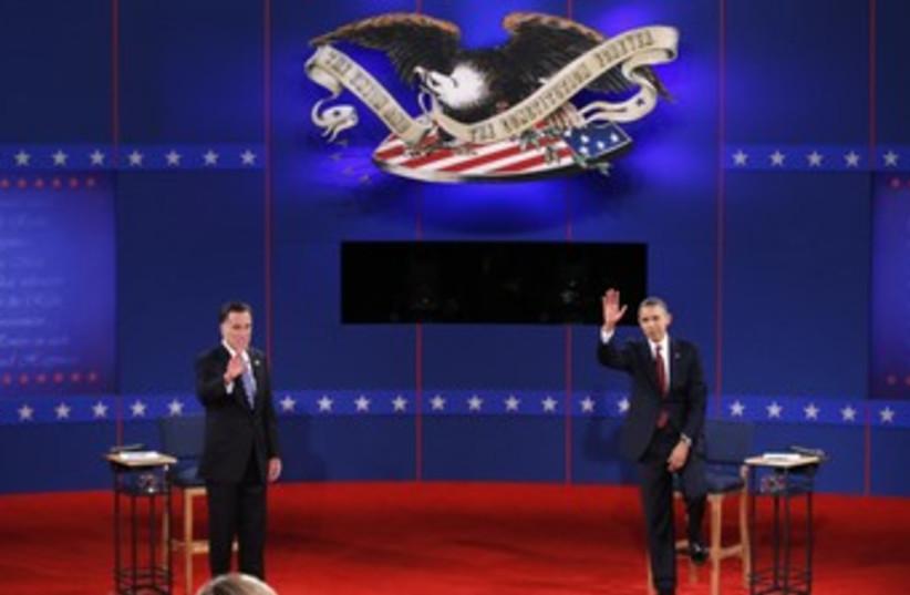 Romney, Obama shake hands at town hall debate 370 (photo credit: REUTERS/Mike Segar)