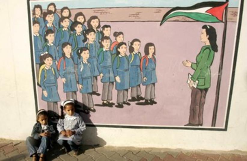 Palestinian kids sit at UNRWA school 370 (photo credit: REUTERS/Ibraheem Abu Mustafa)