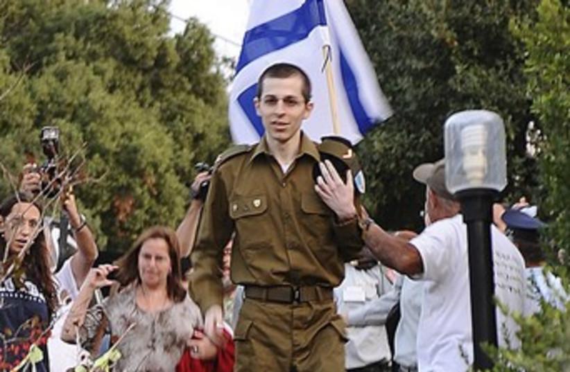 Gilad Schalit arrives from captivity 370 (photo credit: REUTERS/Handout )