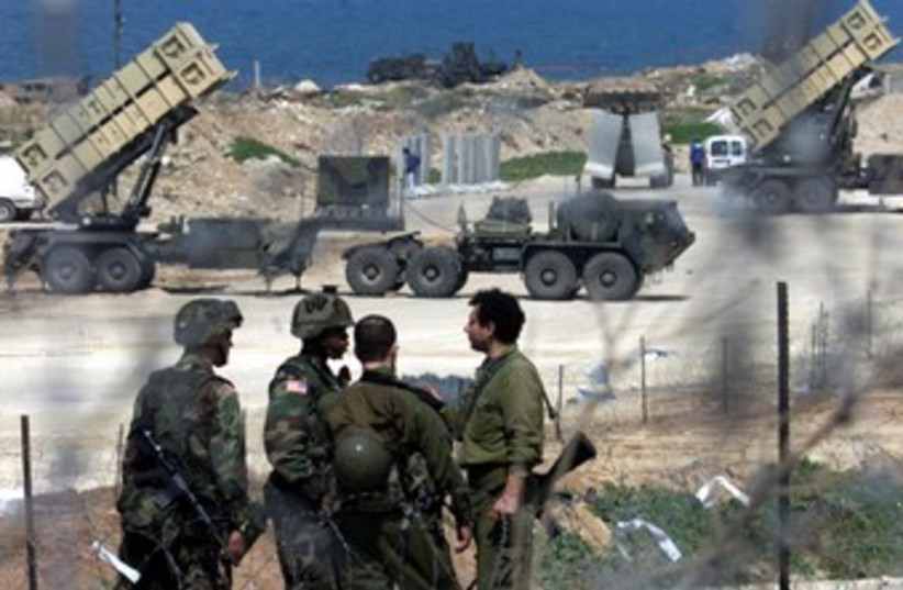 Israeli, US soldiers near Patriot missiles 370 (photo credit: REUTERS/Havakuk Levison)