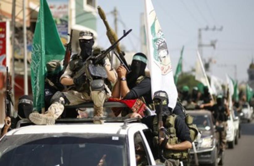 Hamas terrorists mark anniversary of Schalit swap 370 (photo credit: REUTERS/Mohammed Salem)