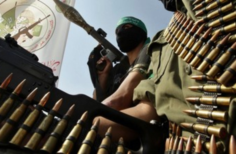 Hamas members take part in a rally 370 (photo credit: REUTERS/Ibraheem Abu Mustafa)