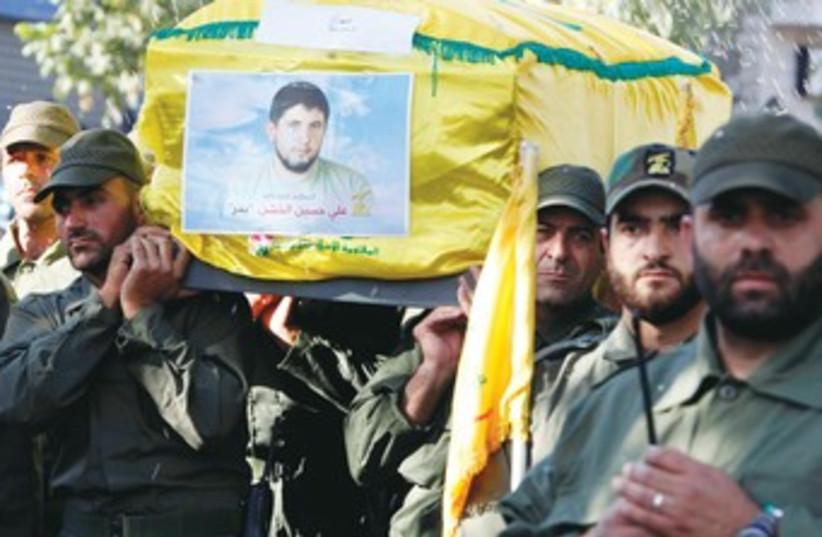 Hezbollah funeral 370 (photo credit: Mohamed Azakir/Reuters)
