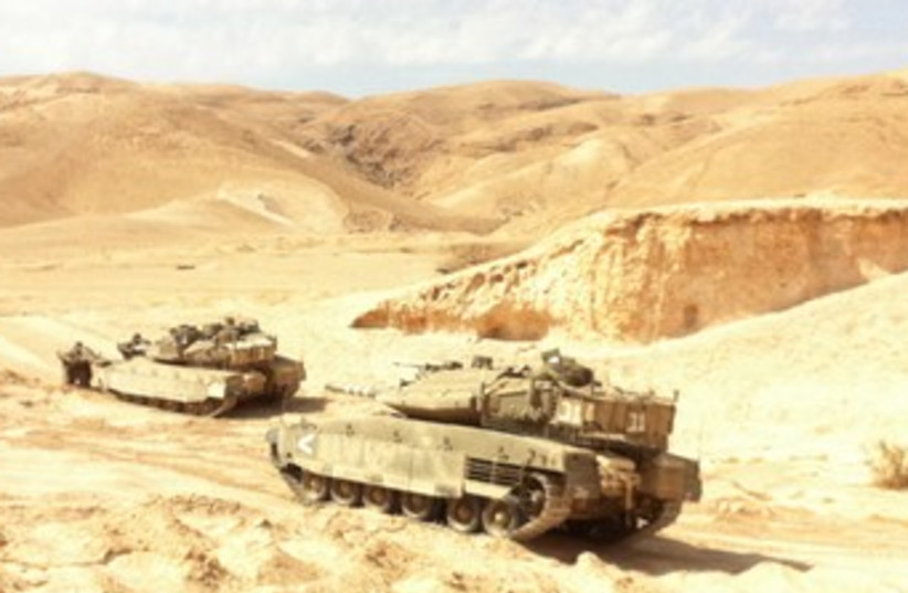BATTALION 9 TANKS hold a war drill 370 (photo credit: IDF Spokesman)
