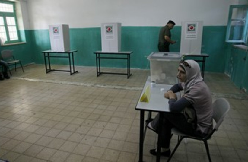 A Palestinian votes in local elections in Ramallah 370 (R) (photo credit: Mohamad Torokman / Reuters)