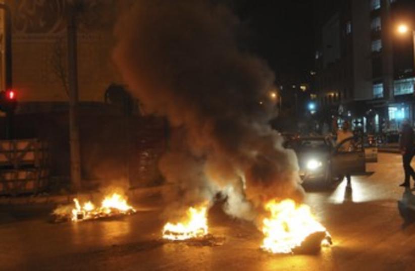 Sunni Muslims burn tires in Lebanon 370 (photo credit: REUTERS/Stringer)
