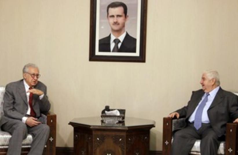Brahimi and Syrian FM 370 (photo credit: REUTERS/Khaled Al Hariri)