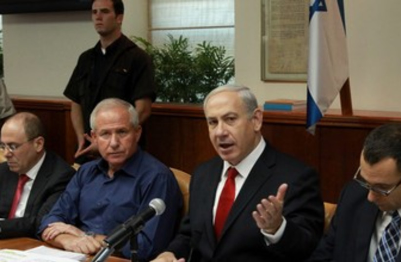 Netanyahu at start of cabinet meeting 370 (photo credit: Marc Israel Sellem/The Jerusalem Post)