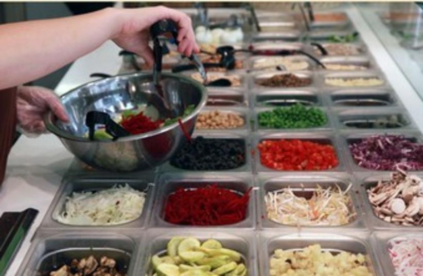 Making salad bar vegetables food health 370 (photo credit: Marc Israel Sellem)