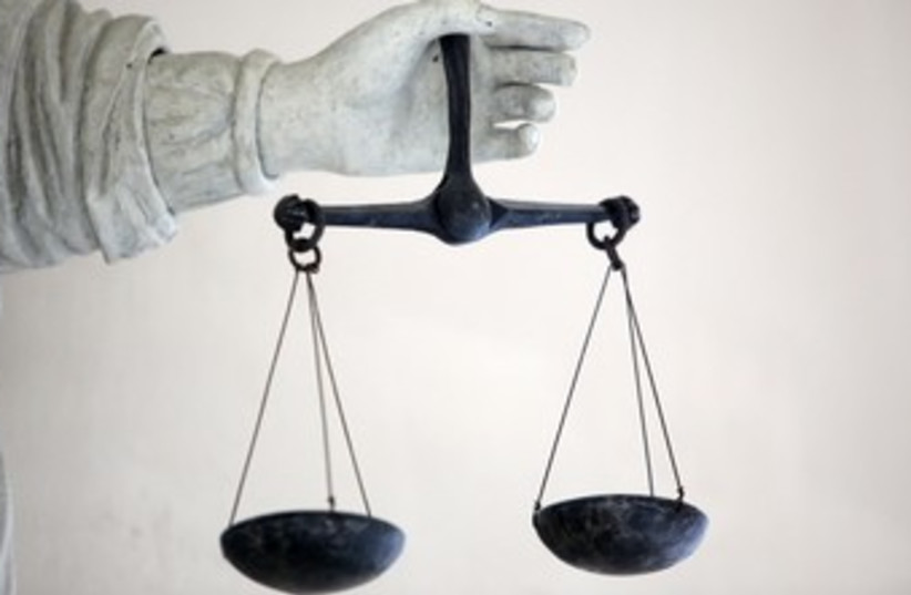 Scales of Justice 370 (photo credit: REUTERS / Stephane Mahe)