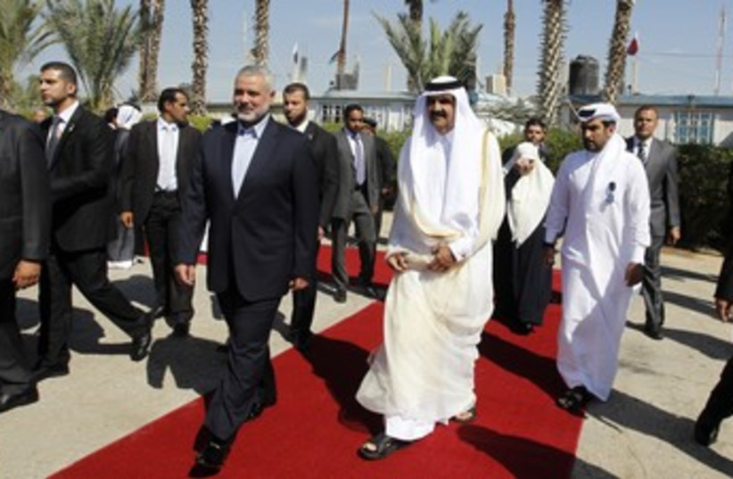 Qatari emir greeted in Gaza by Haniyeh 370 (photo credit: Reuters)
