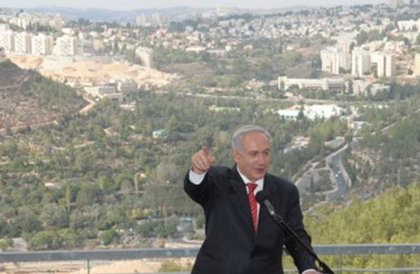 Netanyahu speaking against Gilo backdrop 390 (photo credit: Moshe Milner / GPO)