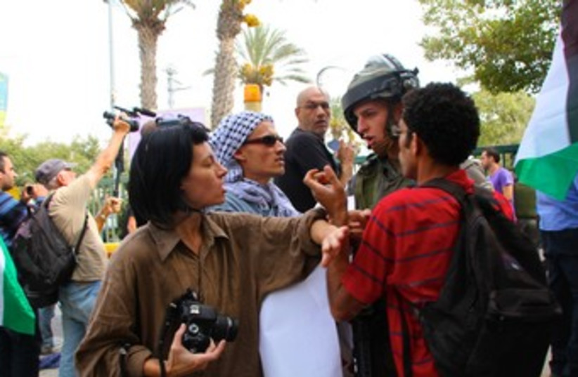 Activists protst outside Binyamin Rami Levy 370 (photo credit: TOVAH LAZAROFF)