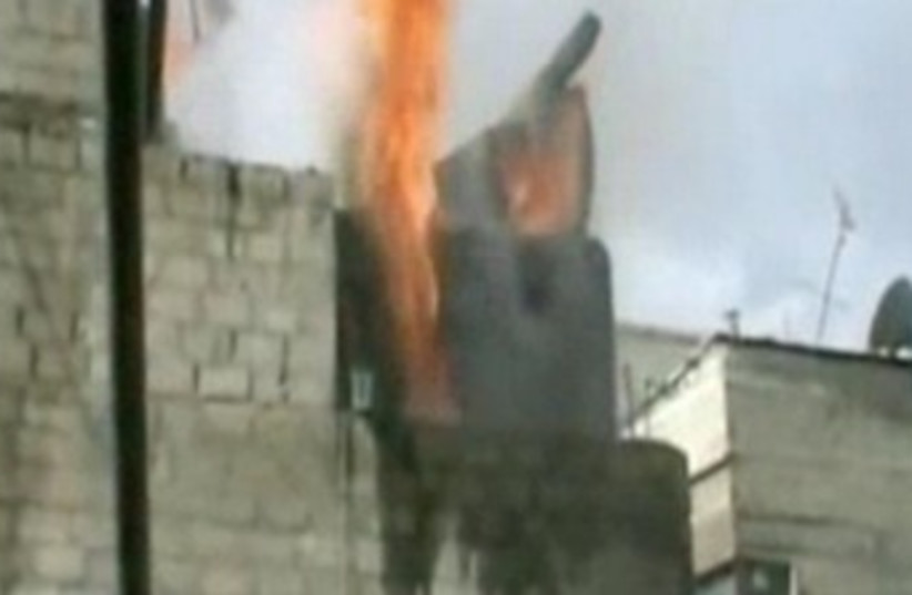 Syrian troops bombard areas in Damascus 370 (photo credit: Screenshot)