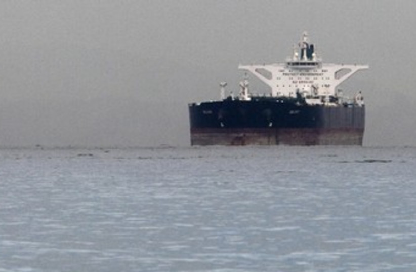 Malta-flagged Iranian crude oil supertanker 370 (R) (photo credit: Tim Chong / Reuters)