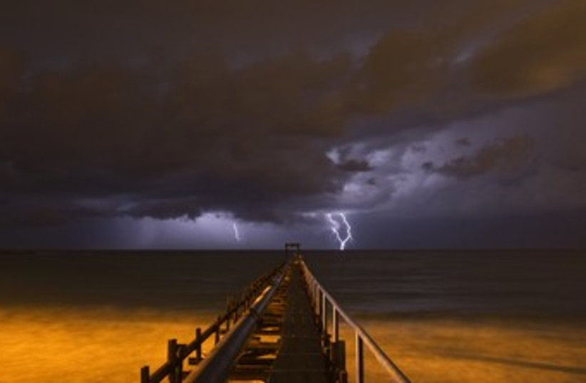 Storm, lightning rain sea thunder clouds 370 (R) (photo credit: Baz Ratner / Reuters)