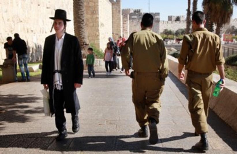 Haredi and IDF soldier Tal law Jerusalem 390 (photo credit: Marc Israel Sellem / The Jerusalem Post)