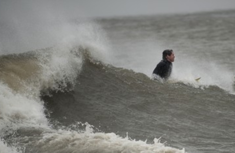 Catching waves before Sandy 390 (photo credit: Keith Bedford / Reuters)