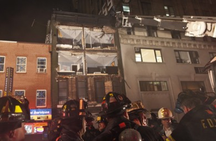 Fire fighters in front of collapsed building