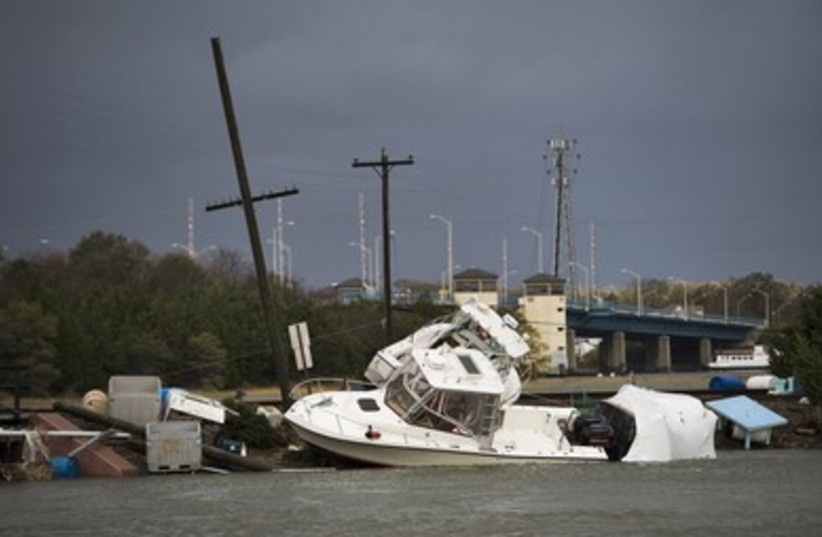 Boats and flotsam washed up by Hurricane Sandy 390 (photo credit: REUTERS)