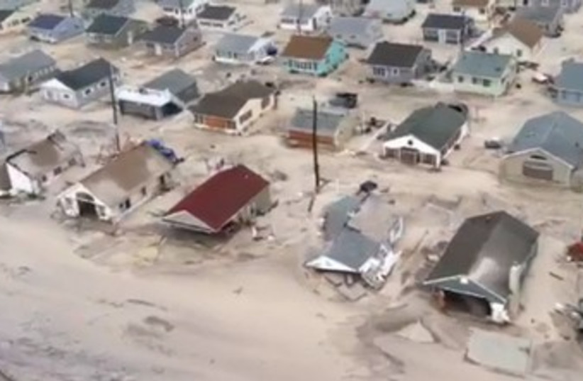 Homes destroyed by Sandy on New Jersey shore 370 (R) (photo credit: REUTERS/Handout)