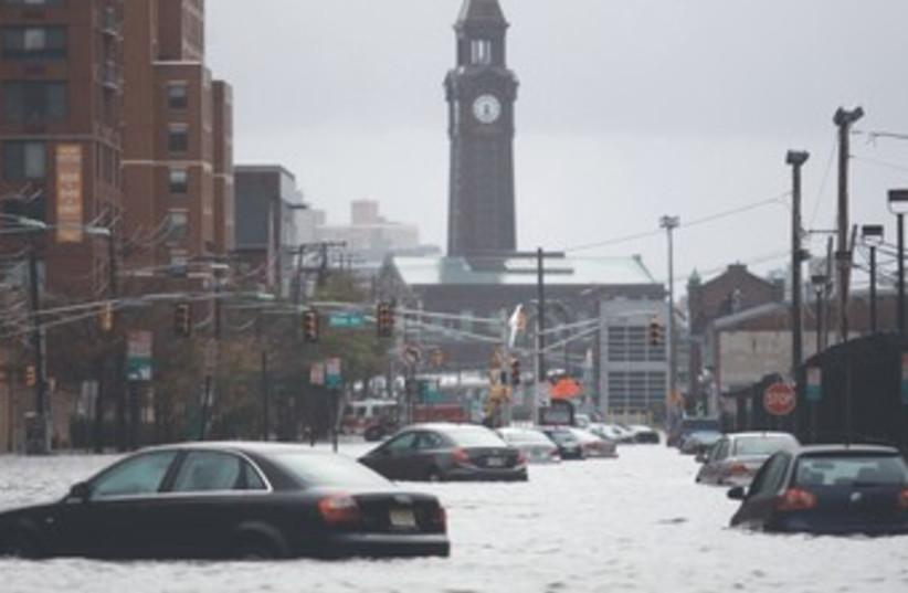 Submerged cars in  Hoboken, New Jersey Sandy flood 370 (R) (photo credit: Eduardo Munoz/Reuters)