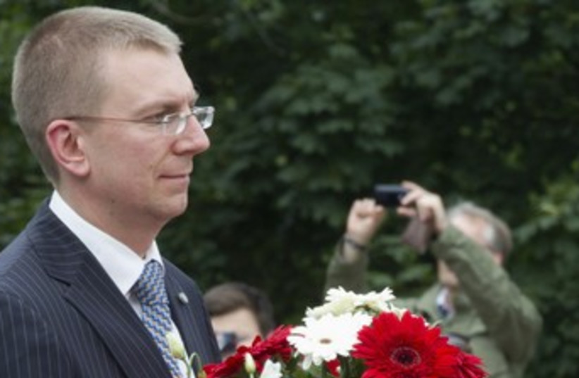 Latvian Foreign Minister Edgar Rinkevics 370 (R) (photo credit: Reuters / pool)