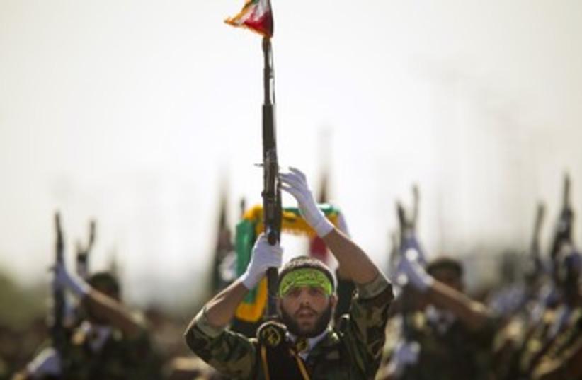 Iran's Basij militia 370 (photo credit: REUTERS/Morteza Nikoubazl)