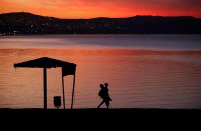 Sunset at the kinneret  370 (photo credit: REUTERS/Ammar Awad)