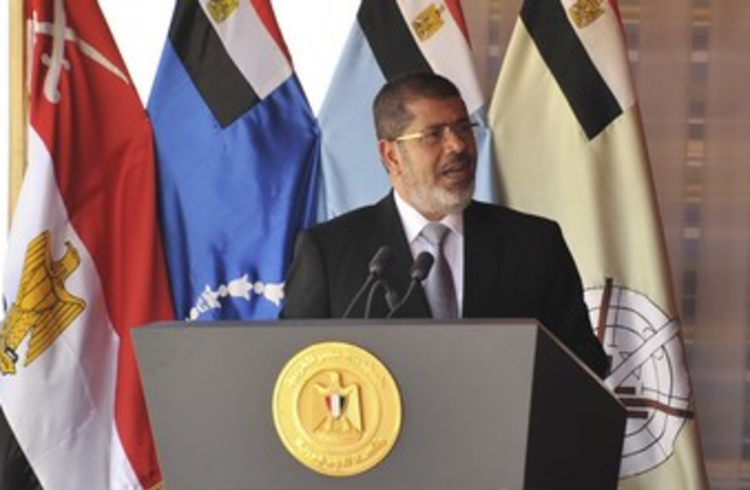 Egyptian President Mohamed Morsy 370 (R) (photo credit: REUTERS / Handout)