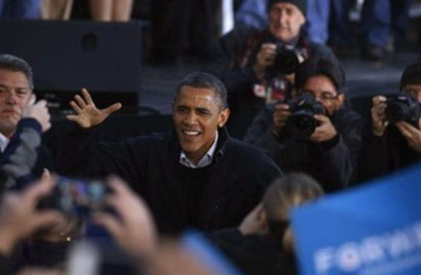 Obama greets supporters during a campaign rally in Dubuque 3 (photo credit: REUTERS)