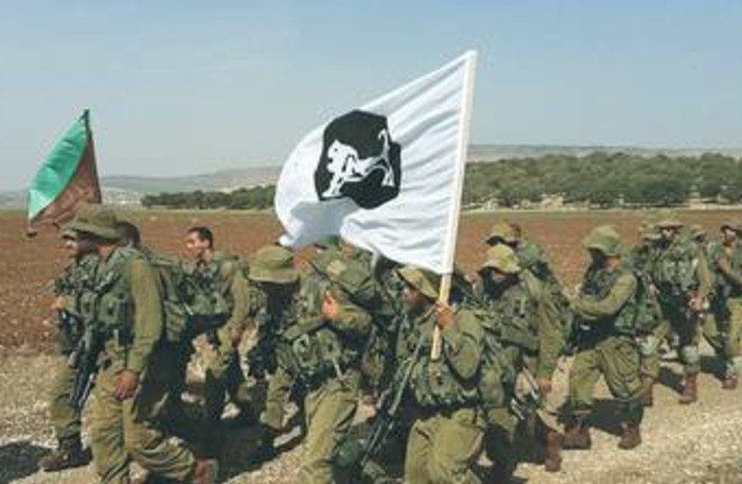 Beduin trackers march during training 370 (R) (photo credit: IDF Spokesman's Office)