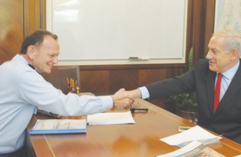 PM,  outgoing military secretary Maj.-Gen. Yohanan Locker 37 (photo credit: GPO)