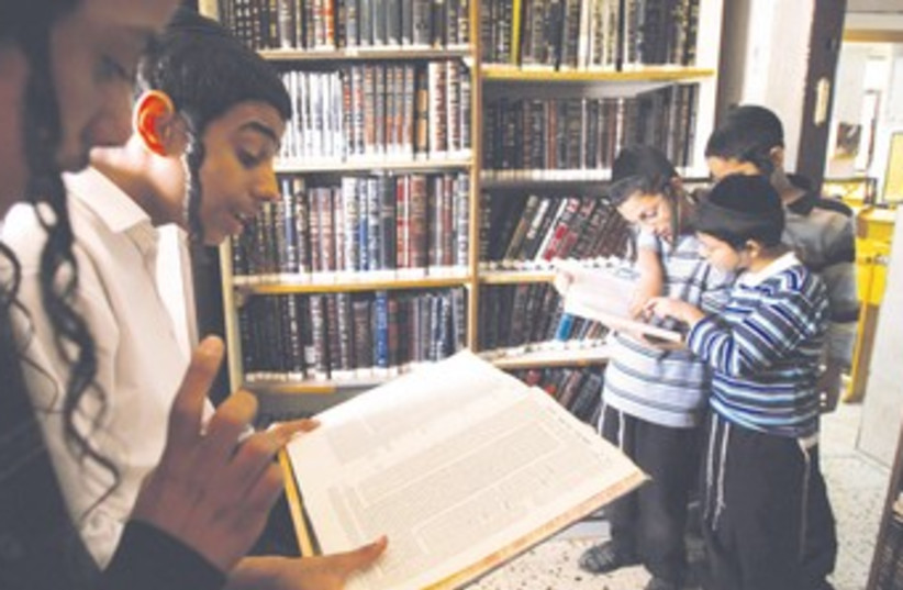 BOYS STUDY Talmud at their school's synagogue in Bnei Brak 3 (photo credit: REUTERS/Gil Cohen Magen)