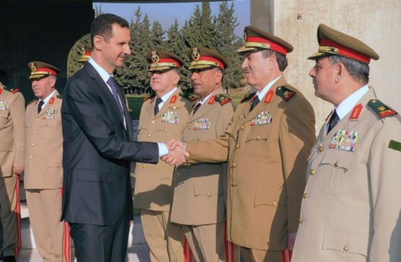 Assad and generals 521 (photo credit: REUTERS)