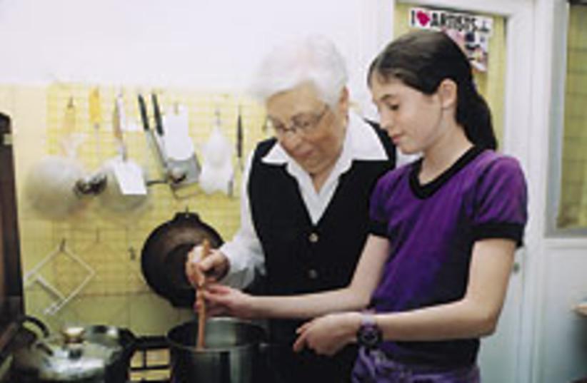 girl cooks 88 224 (photo credit: Jerusalem Post Archives)