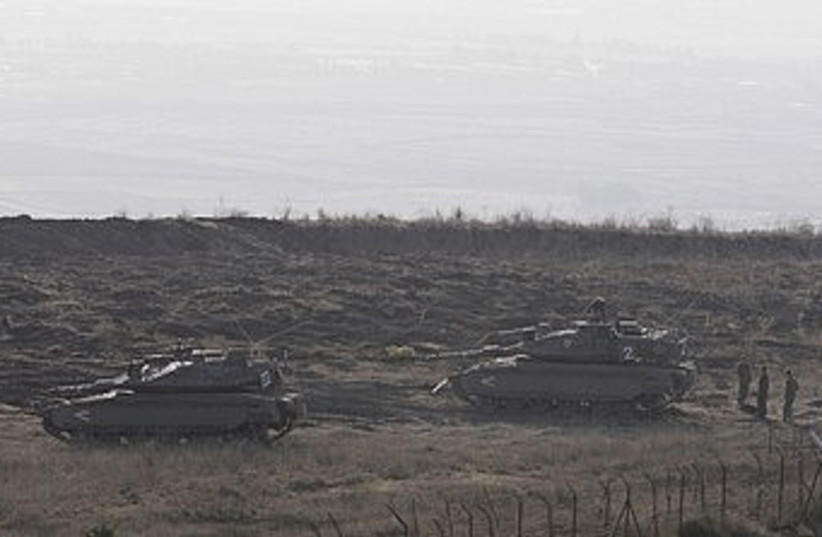 IDF tanks along the Syrian border on Golan Heights 370 (R) (photo credit: Baz Ratner / Reuters)
