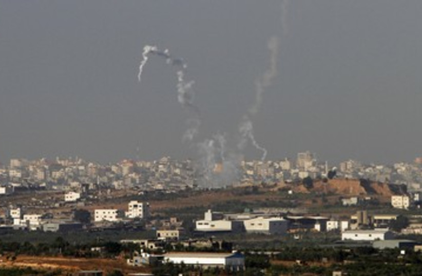 Trails of smoke from Gazan rockets 390 (photo credit: Amir Cohen / Reuters)
